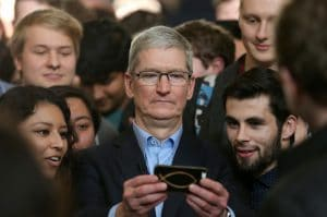 apple ceo tim cook showing iphone