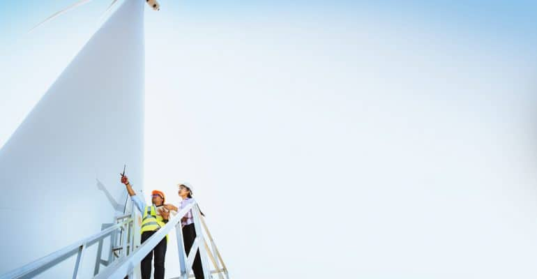 employees working on a wind mill