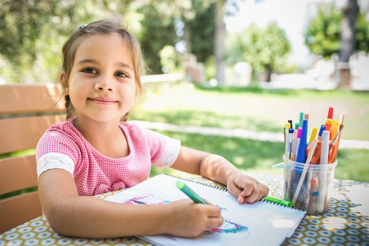 Little Girl Painting Picture Outside