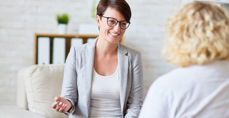 A counselor with a public health background speaking with a client.
