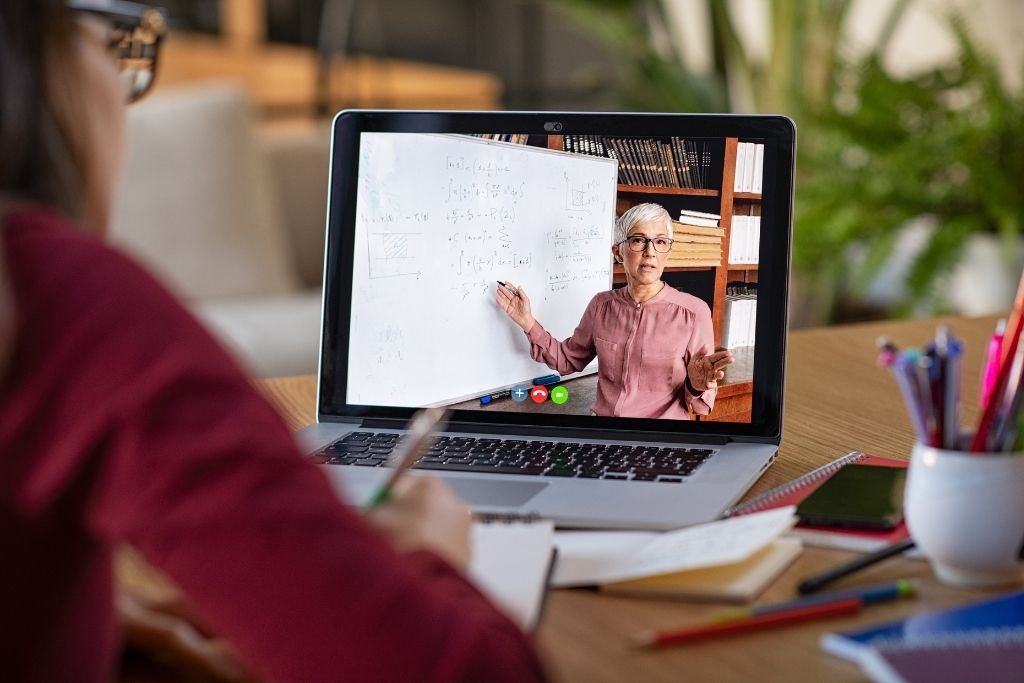 A college professor teaches a construction management student via an online course