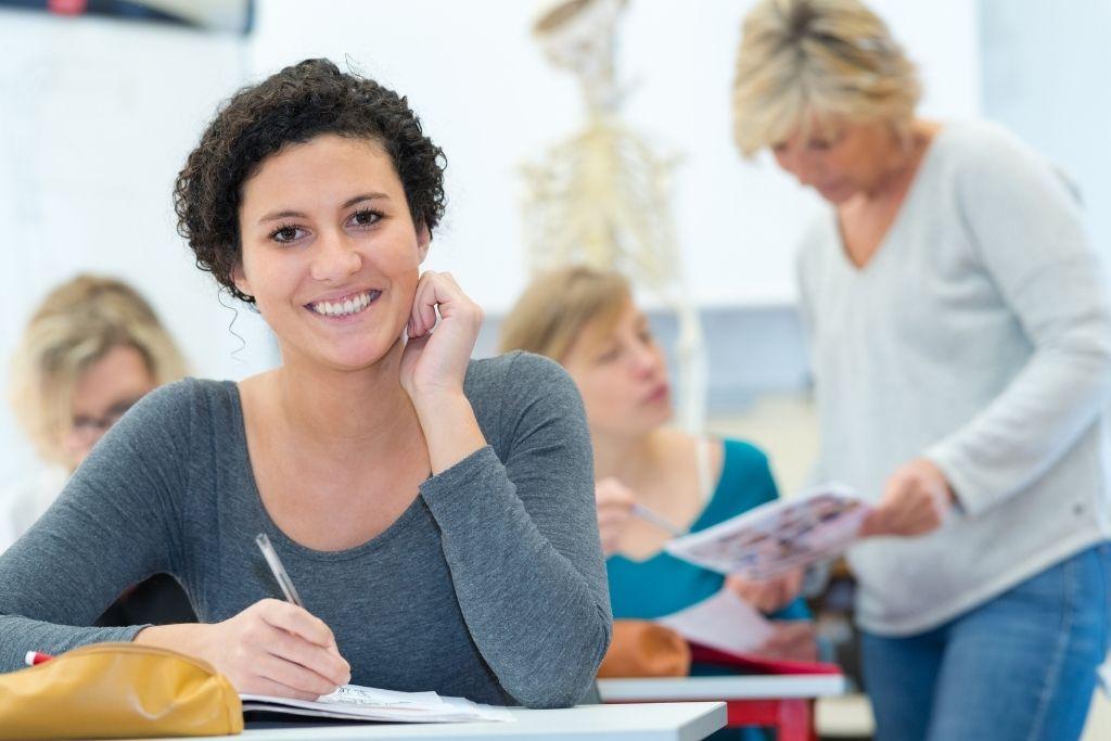 A female alternative medicine student sits in class.