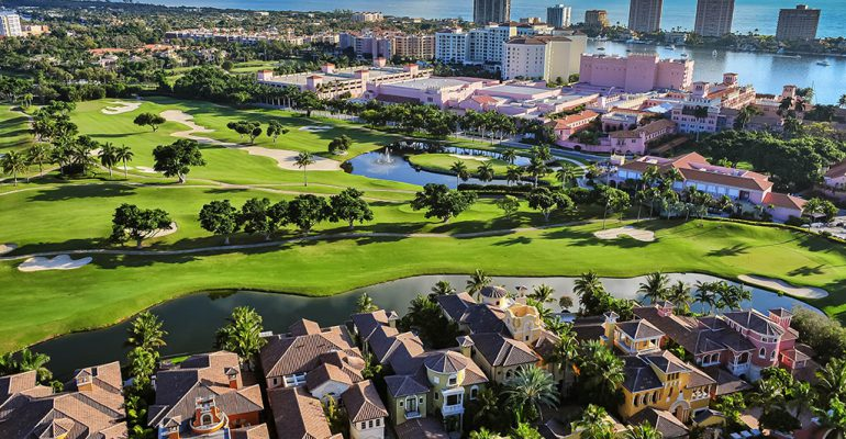 An aerial view of Boca Raton, Florida, over a golf course, homes, and the Atlantic Ocean