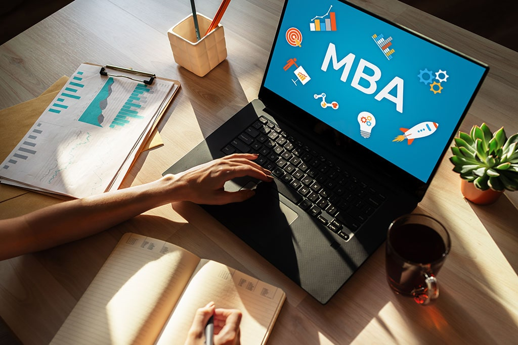 Woman studies for an MBA at a table.