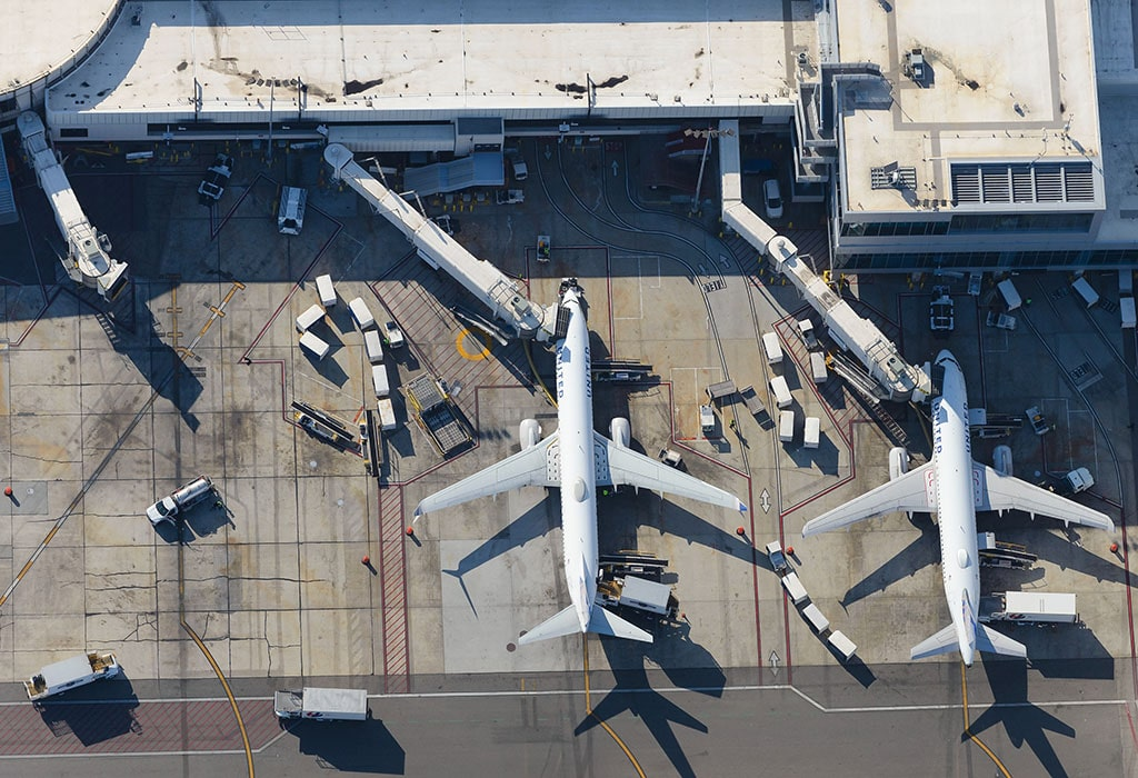 Airplanes at a terminal of an airport.