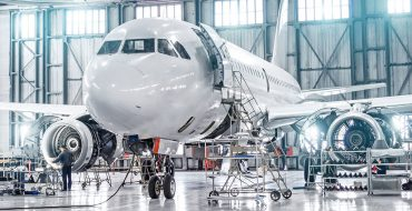 An airplane getting maintained.
