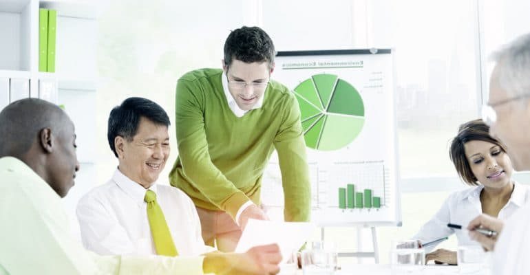 Businessmen discuss green policies in a meeting room