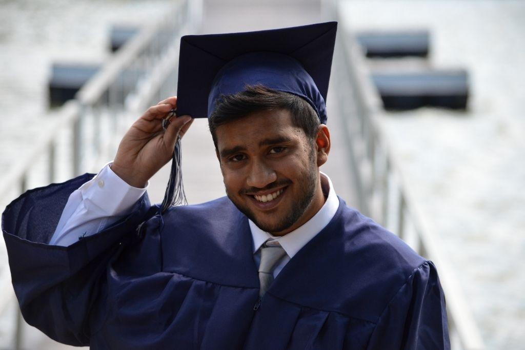 Older student wearing university regalia